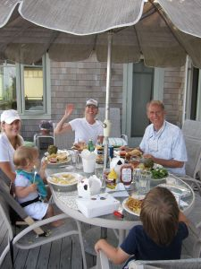 Dinner on the deck. Angie says hi. That's Abby, her summer helper, on the left. Jamesy and Thomas, too.