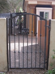 We covered this gate with hardware cloth when we noticed the cats easily slipping through the bars