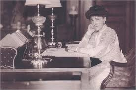 Author Edith Wharton at her writing desk (image from southernbluestocking.com)