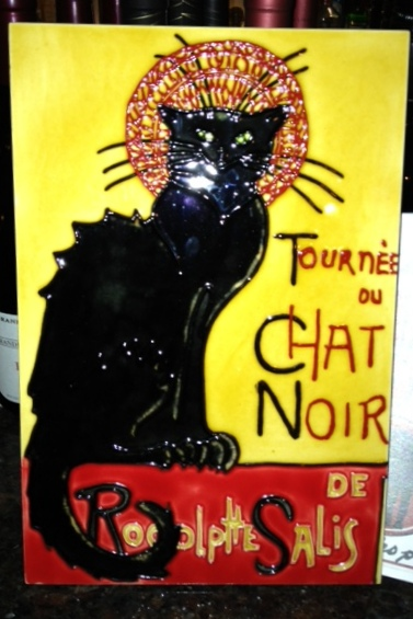 You know you're at Bistro Chat Noir when you see this sign