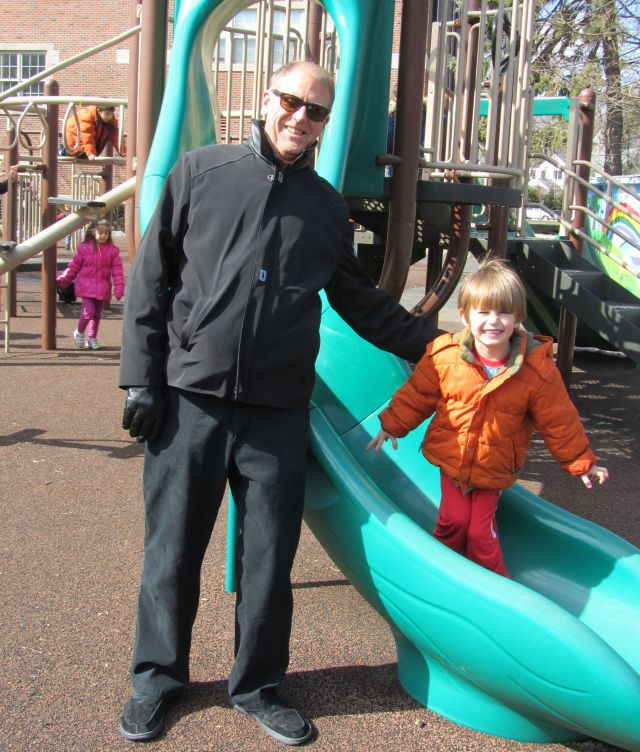 Grandpa and Jamesy on the playground slide at Bronxville on a rare sunny day.