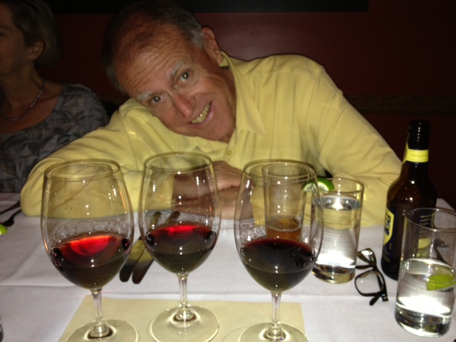 The CE admires a wine flight at Artisan