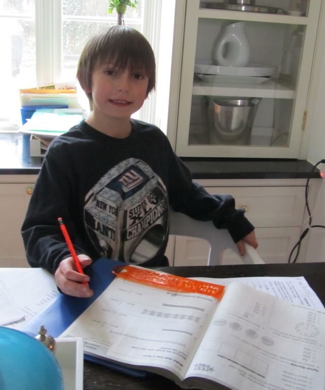 Thomas doing his homework. We hear he got a glowing report at his parent-teacher conference this week.