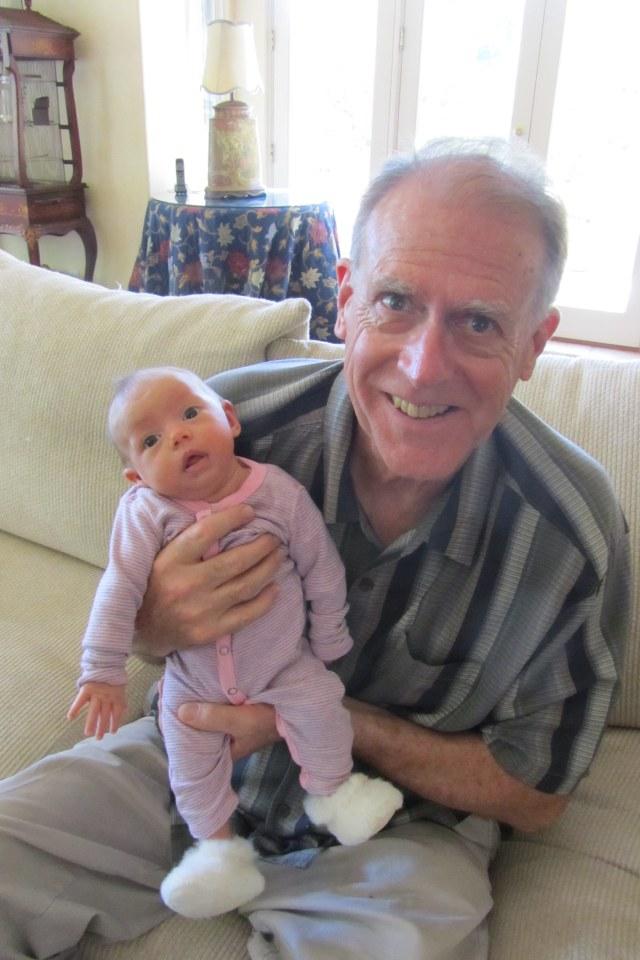She's so tiny in her Grandpa's arms!