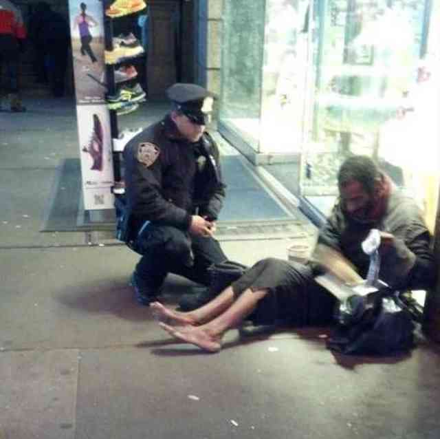 "The famous photo: NYPD officer gives a pair of boots to ""homeless"" Jeffrey Hillman (image from news.yahoo.com)"