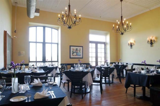We sat in this room and had a great view of the river beyond. (image from americascuisine.com)