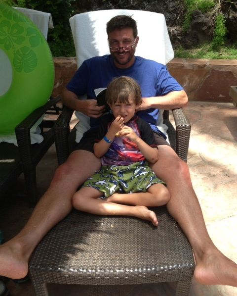 Bobby and James relax by the pool.