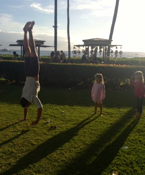 Uncle Daniel entertains the girls on the lawn  at Hula Grill after dinner.
