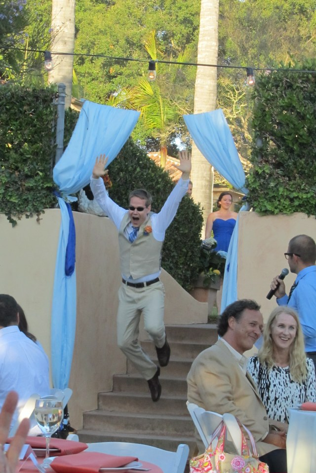One of Andy's groomsmen making his entrance at the reception.
