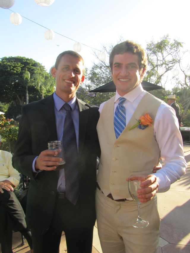 Two of Andy's groomsmen relax after the ceremony.