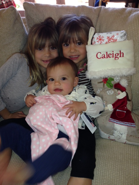 Caleigh got a stocking for her first Christmas (photo credit to Tina)