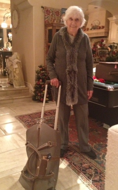 Granny looking good with her new sweater and suitcase.