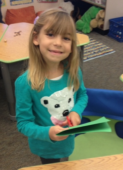Evie in her classroom