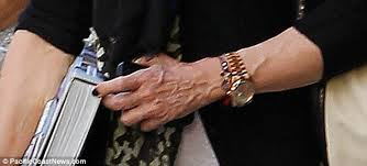 Uh oh: the Daily Mail caught Madonna's show of hand.
