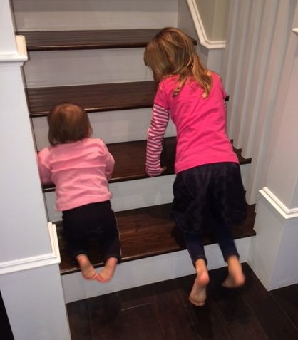 She's also learning to go up the stairs, thanks to big sister Evie.