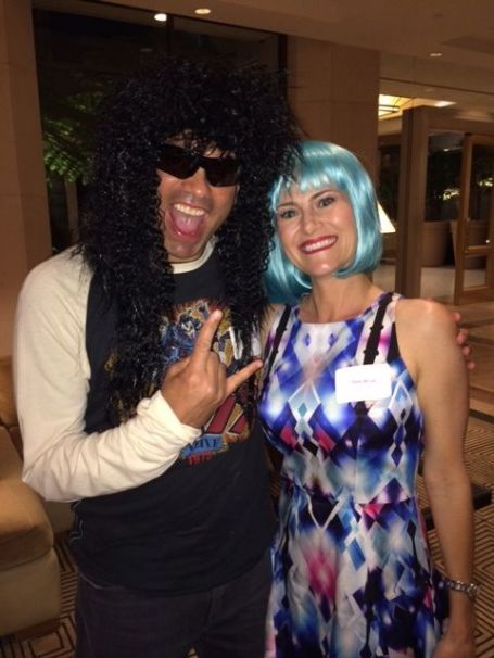 It was a hairy situation: John and Tina get into the wig theme for the school auction.