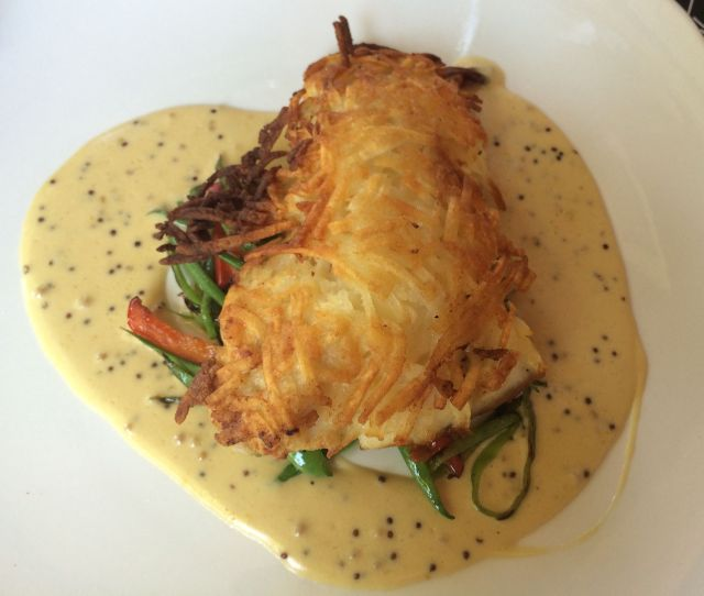 The Potato-Crusted Grouper is a deservedly popular entree at Cafe L'Europe.