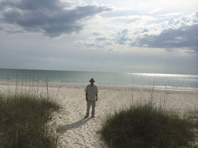 The CE on the lovely Naples beach. He'll move there if you don't make him wear a jacket for dinner.