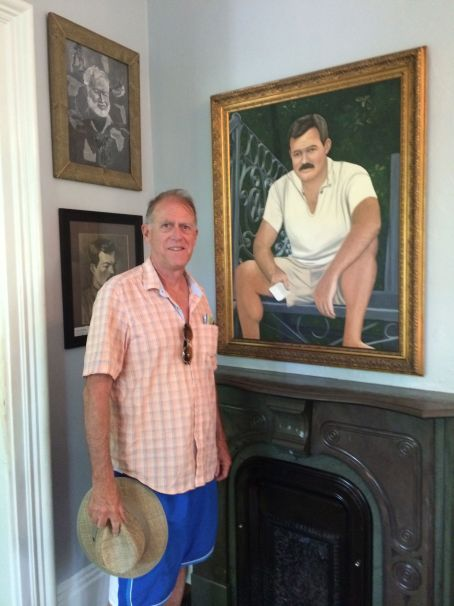 The CE next to a portrait of Hemingway.