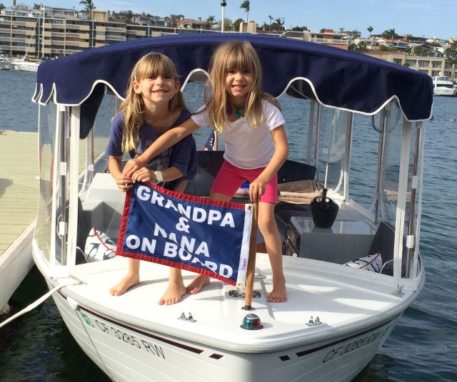 Here are Evie and Viv unfurling our personal flag on their Duffy boat.