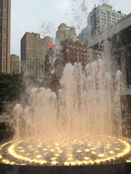 You can cool off by the fountain at Lincoln Center on a warm summer night.