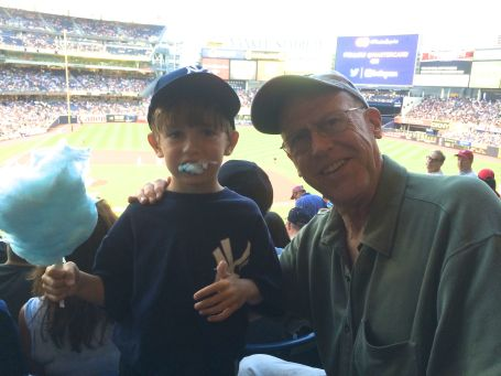 James and Grandpa enjoy the game.