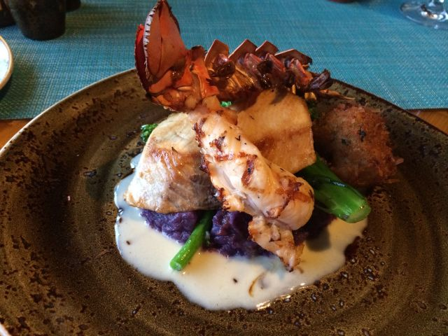 "Tidepools ""Hawaiian Catch"": monchong and a shrimp cake over a bed of molokai sweet potato, topped with kona lobster tail."