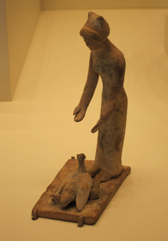 This Getty Museum statuette of a woman feeding hens and chicks dates from Boiotia, 500-475 B.C.