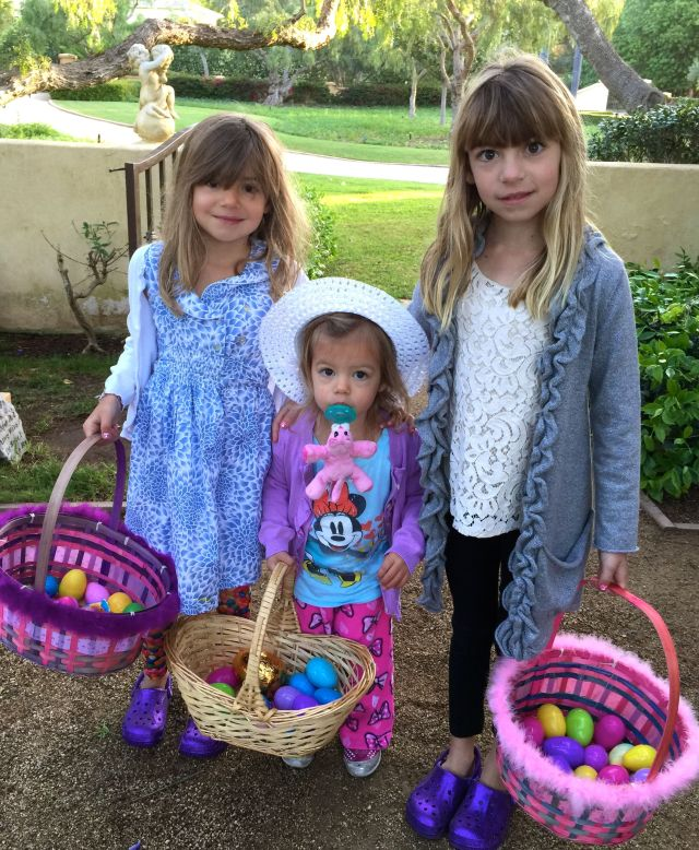 Viv, Caleigh and Evie with all the eggs they found.