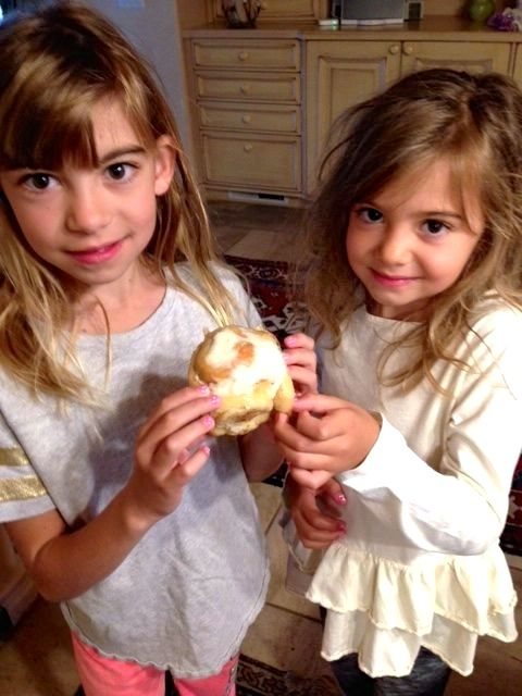 Evie and Viv share one of Granny's famous sweet rolls.