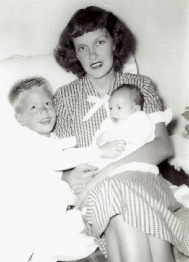 Phyllis with the CE and baby Mark. Gail made her spectacular debut a few years later.
