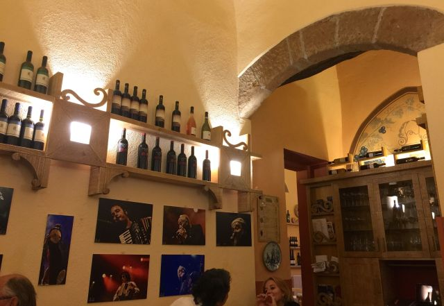 The cozy dining room at Trattoria del Moro Aronne.