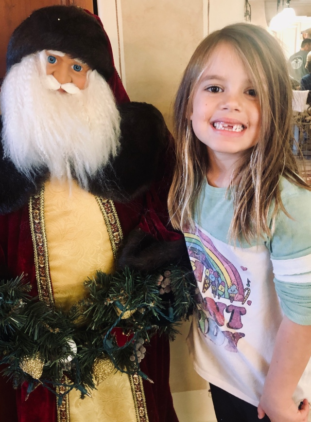 Caleigh and the tall santa 2018